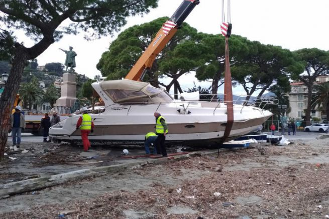 Motor boat pushed ashore by a storm