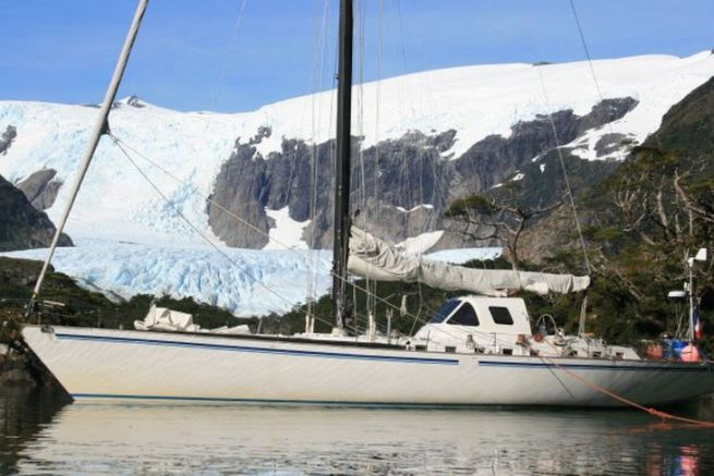 The Paradise yacht on a stopover at the foot of a glacier