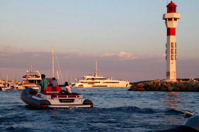 Yachts at anchor and semi-rigid in Cannes