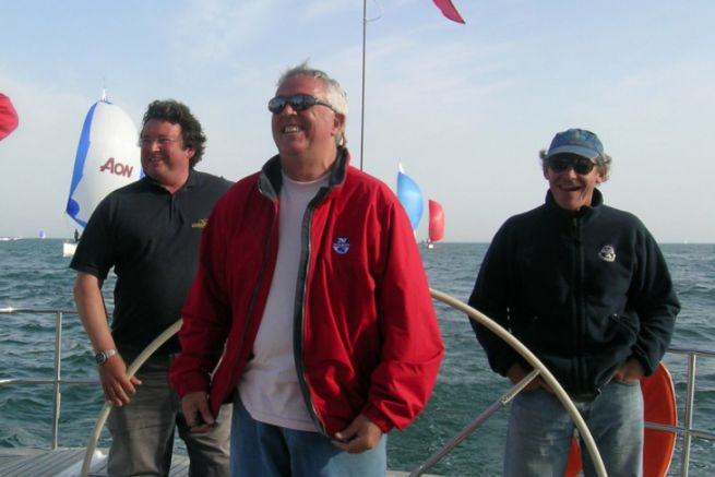 Laurent Tilleau in the centre (in red), surrounded by Philippe Poupon, Gérard Dupuy and Jean-Yves Furic aboard the Grand Soleil Race 45
