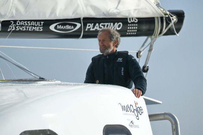 Michel Desjoyeaux at the helm of the Z2015 de Mer Agitée catamaran