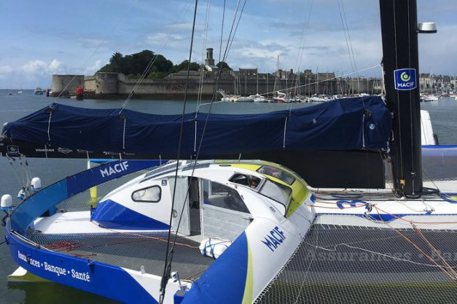 The trimaran Macif during the laying of the first stone of the Mer Concept building in Concarneau