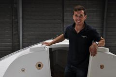 Thibaud Ramond, founder of Dream Racer Boats, poses on his Figaro1