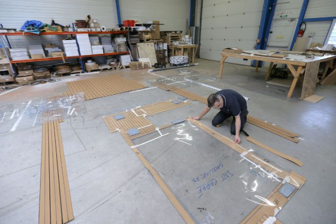 Workshop preparation of a Flexiteek synthetic teak deck