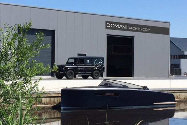 Motorboat Domani E32 from Domani Yachts in front of the new factory in Drachten